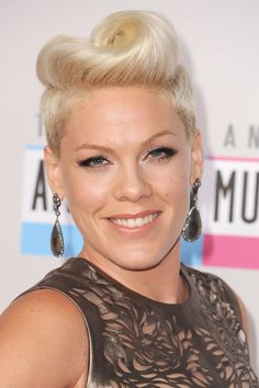 Pink: If there's one think Pink knows, it's how to pull off a retro hairstyle. The singer and COVERGIRL twisted her platinum strands into an updated victory roll, finishing the look with winged eyeliner and ultralong lashes.