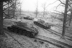 T-34 tanks take the position. The 3rd Byelorussian Front. A 1944 photo. The Great Patriotic War of 1941-45. Source: RIA Novosti