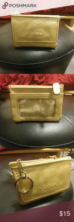 Gold Leather Fossil Card Holder Never taken it out of the house. Like new. Perfect for a casual night on the town when you don't want to carry a purse or a clutch. Sturdy snap pocket closure on front. Zipped pocket for secure items. Back has a clear card holder for your identification. Also equipped with a key ring that can be tucked into zipper compartment. Fossil Accessories Key & Card Holders