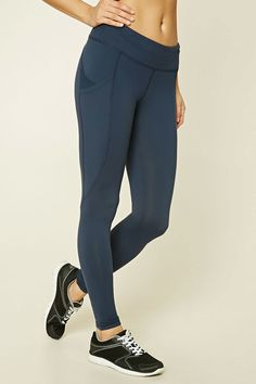 12c3c0d83c3 A pair of stretch-knit leggings with mesh-paneled patch pockets on both  sides