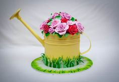 "https://flic.kr/p/a9u3Q2 | Mum's watering can | 6"" extended height.  Mango cake with coconut ganache filling.  Everything is edible except for the spout.  Had problems with this cake but in the end, I was happy with it especially mum since she didn't expect it.  The roses took me forever!  The handle fell off.  It didn't harden up during the week because of the VERY wet weather we've been having in Sydney.  The painted grass on the edges of the board was inspired by someone whom I cannot…"