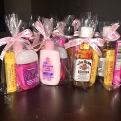 baby shower favors for guests! women's: Burt's Bees lip balm, Johnson's Baby Lotion, Bath & Body Works antibacterial gel. men's: Burt's Bees lip balm, Trident bubblegum, assorted mini liquor shots.
