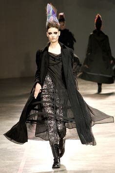7. Crinoline Hoop Skirt: Yohji Yamamoto Fall 2011 Ready-to-Wear Collection. Yamamoto alludes to the structural foundation of the Crinoline Hoop skirt, but exposes the frame with the use of sheer lace.