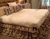 I really like these Mr & Mrs pillows and the ruffled bed skirt.   Burlap Ruffled Bed Skirt King and Queen. $290.00, via Etsy.