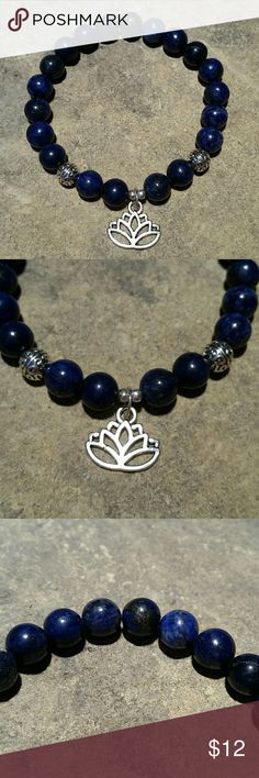 "Lapis Lazuli & Silver Lotus Boho Mala Bracelet New, beautifully handcrafted in Florida, this bracelet features large 8mm genuine deep ocean blue lapis lazuli stone beads accented by a Tibetian silver metal beads & a lotus flower dangling charm. Perfect for chakra, healing, yoga meditation work, enjoying it's beauty alone, or layering with my other stacker bracelets! Thick high quality stretch beading cord, 6.5"" inside circumference.   Thank you for visiting my closet, and happy poshing!! :)…"