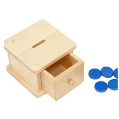 Montessori Infant Coin Box develops sequencing, challenges eye hand coordination and a pincer grasp.