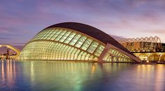 L'Hemisfèric, an Imax Cinema, Planetarium and Laserium, is the centerpiece of the City of Arts and Sciences in Valencia, Spain. The building was designed by Santiago Calatrava and Félix Candela and is meant to resemble a giant eye.