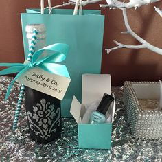Breakfast at Tiffanys theme from my baby shower. Party favors I gave out to all the ladies. DIY Mini decorated Korbel champagne bottles and mini Kleancolor nail polishes. Used a Martha Stewart stencil sheet, loose glitter and glue and black chalk paint for the bottle