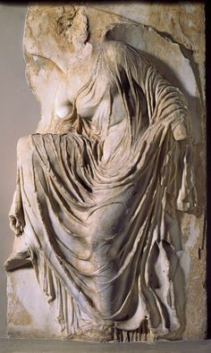 Nike (Victory) Adjusting Her Sandal, Ancient Greek, Fragment of the relief decoration from the parapet (now destroyed), Temple of Athena Nike, Acropolis, Athens. Marble, last quarter of the 5th century.