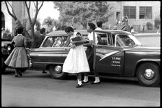 Students arrive at Central High School in Little Rock, Arkansas in an Army car, 1957