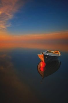 Boat with calm water.