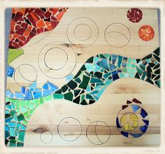 Mosaic Table....see how she starts to lay a small dining table top out for mosaic.