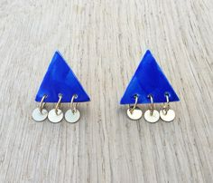 Those are 80s triangle handmade ceramic earrings. The materials are gold brass, and handmade deep blue glazed ceramic.    This item is ready to