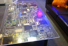 Don't chuck away those old PC parts just yet! Any old hardware you may have lying around could be transformed into geeky furniture--just like Chris Harrison's coffee table made from old motherboards.