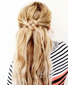 Achieve the Celtic knot hairstyle by putting those knots in a half-up, half-down 'do.