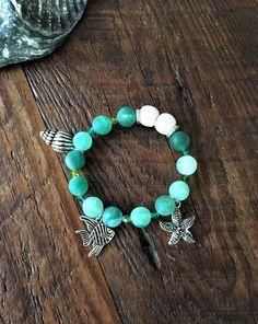 Aromatherapy Beaded Charm Bracelet, Sea Green Agate Bead and Lava Stone Bracelet, Diffuser Bracelet, Essential Oil by IGZDesigns on Etsy #aromatherapyjewelry #lavabeadbracelet #starfishbracelet #fishcharmbracelet #silvercharmbracelet