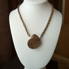 Kumihimo necklace with ammonite pendant.