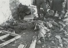 The body of the pict above are not a dead American soldier, but the body of a German Grenadier wearing GI uniforms and equipment. He was one of Otto Skorzeny's men who was shot dead at Hotton on 26 December 1944, one round in the Battle of the Bulge