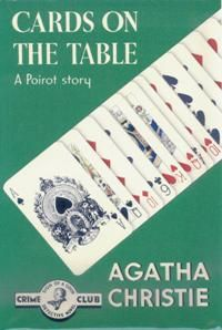 Dust-jacket illustration of the first UK edition.   Agatha Christie's novel:  Cards on the Table (1936).  Hercule Poirot, Superintendent Battle, Ariadne Oliver, and Colonel Race, all recurring characters.