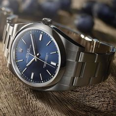Rolex Oyster Perpetual 39 with a rich blue dial. A modern heir to the original Rolex Oyster with a zest of eye-catching and sporty colours, the Oyster Perpetual is available in five different sizes.