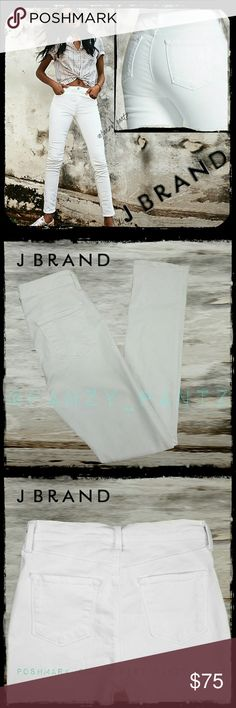 J Brand 'Rail' high rise white stretch jeans 26 A perfect summer jean. Popular J Brand 'Rail' white jeans. High rise jeans with the perfect amount of stretch. The color is 'blanc ', True white. Excellent condition, any discoloration in photos is due to shadows and/or lighting. No stains, rips, holes, fraying.  See last photo for measurements, fabric content, and other details. NO TRADES PLEASE! REASONABLE OFFERS WELCOME THROUGH OFFER FEATURE ONLY PLEASE!  5159 J Brand Jeans