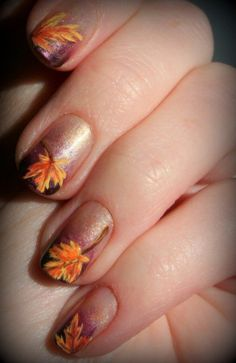 20 Fantastic Nail Designs for Thanksgiving: #9. Shimmer Maple Leaves Nails