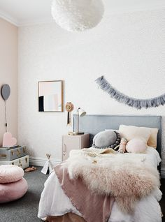 The norsuHOME - Annabel's Bedroom  Photographer: Lisa Cohen Stylist: Beck Simon  Paint: Dulux Mornington Half Wallpaper: These Walls Carpet: Godfrey Hirst   Products:  Vita Copenhagen Feather Pendant, GlobeWest Vittoria bedhead, Tracey Mock Original Art, Mustard Made Locker, norsu cushions (all available at www.norsu.com.au)