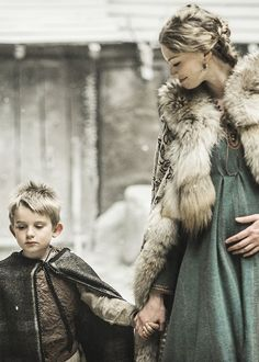 Cersei Lannister, after she married Rhaegar, walking with his heir and carrying his child.