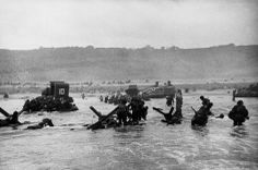 Robert Capa Omaha Beach. June 6th, 1944. American soldiers landing on Omaha Beach, D-Day, Normandy.