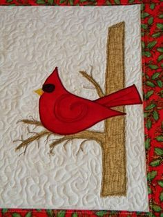 free motion quilted, raw edge and thread art applique Christmas placemat, cardinal