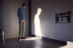Mysterious man casts a lit up silhouette instead of a shadow