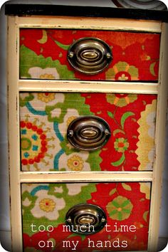 i have an old dresser (same pulls!) in my garage that i would love to do this to, one of these days! decoupaged with fabric        Done with fabric!