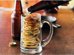 "These maple and bacon flavored ""mancakes"" are so creative! Pour maple syrup out of a beer bottle for a unique serving idea."