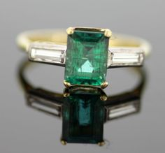 Currently at the #Catawiki auctions: 18K yellow gold ladies ring with emerald (2.36 ct) and diamonds (0.20 ct tota...