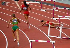 Day 9 - Bulgaria's Vania Stambolova crashes into a hurdle as Lithuania's Egle Staisiunaite and T'Erea Brown of the U.S. run in the women's 400m hurdles round 1 heat during the London 2012 Olympic Games at the Olympic Stadium . DAVID GRAY/REUTERS