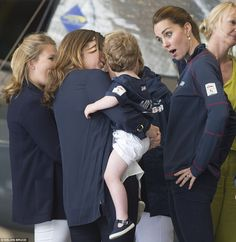 The Duchess pulls a series of funny faces to try and cheer up a tearful tot while also chatting to her mother