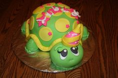 Turtle Birthday Cake - 4 stacked 8 inch rounds for body.  Fondant covered head and body, feet are all fondant.  Inspired by cakes on CC!  Thanks for looking!