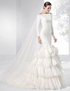Vestidos de novia con volantes de organza, satén y organdí.