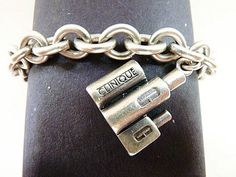SoVintageous is offering this fabulous vintage sterling silver bracelet with a wonderful sterling silver Clinique bottles charm.  This heavy charm bracelet has a Prochain hallmark on 2 links that I co