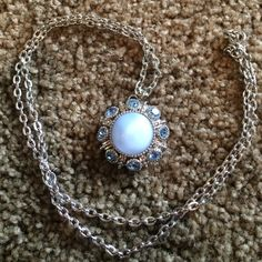 Blue Rhinestone Necklace Blue/white stone necklace lined with blue rhinestones. 24 inch chain. Jewelry Necklaces