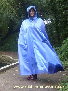 Fancy a peak under this hot babe's Rubber Rainwear? Find more on our website!