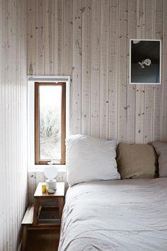 A blonde timber cabin on the Danish coastline