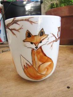 fox painting on mug