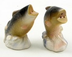 """Bass Salt and Pepper Set by IWGA. $13.95. Bass Salt and Pepper Set. Ceramic salt and pepper set perfect for the fisherman in you life. Measures 2.5""""W x 3.25""""H x 1.5""""D."""