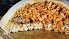 This Timpano di pasta recipe was inspired by the iconic scene in the 1996 movie Big Night. Layers of pasta with meatballs, sausage and cheese are enclosed in a pie crust. Timpano Recipe, Ricotta Meatballs, Stuffed Pasta Shells, How To Cook Sausage, Rigatoni, Pasta Recipes, Macaroni And Cheese, Zucchini, Tasty