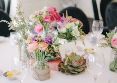Mason jar floral centrpieces mixed with vintage books and succulents. Photo by Tealily Photography & florals by Butterfly Philosophy.