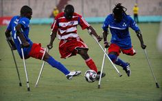 Resilience: members of the Haitian amputee soccer team who lost their legs during the 2010 earthquake play a friendly match