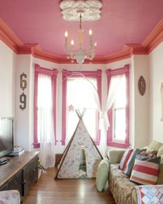 Great use of color in shades of pink. Remember to use a high quality high gloss paint on ceilings to reflect the light. And when used on trim, will prolong the wear!