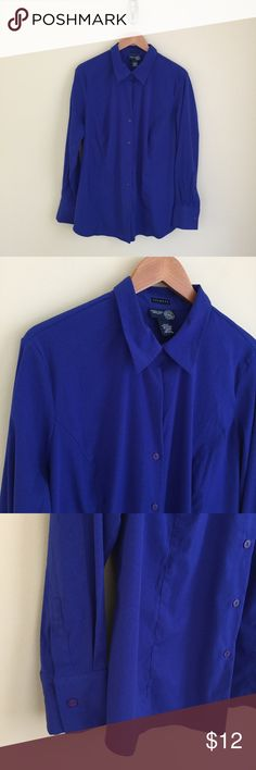 """Venezia Jeans royal blue stretch blouse sz 18/20 Venezia Jeans royal blue stretch blouse, size 18/20. Vibrant royal blue, stretchy fabric has a sheen, tailored style , rounded hemline. Condition:  very good pre-loved. Flaw:  there is a small area of faded marks on the left rear hip above the hemline (photo 5). Material:  74% polyester/22% nylon/4% spandex. Measurements (approximate, taken laying flat):  length from shoulder 27"""", pit-to-pit 24.5"""", flat waist 23"""", flat hem 26"""", sleeve 25""""…"""