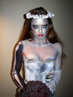 This makeup, floral headpc, fake eyelashes that are attn grabbing, some black body paint, black or grey fabric dye and an old secong hand Goodwill bridal gown.  Rememb..  you can always modify the dress, it's Halloween, you can do whatever you want, yo!  -C    Credits:  adriana lima as the corpse bride... impeccable!
